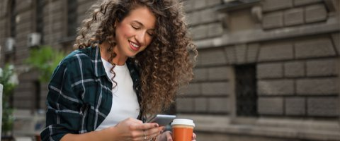 Young woman getting instant cash advance on her phone