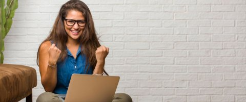 a woman excited after getting an online loan