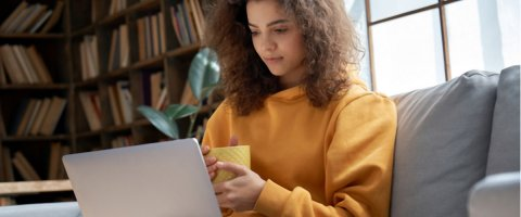 Woman looking at lines of credit online