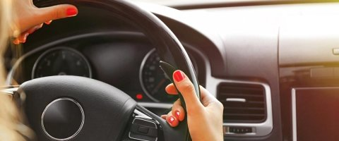 A woman drives her car to Advance America for LoanCenter title loan