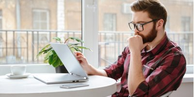 Man researching hard and soft credit checks online