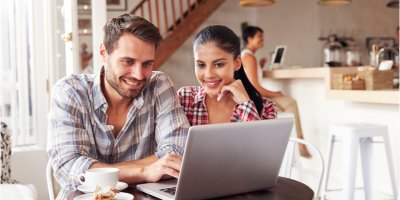 Couple looking at loan refinance options online