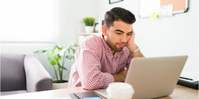 Worried man looking at his computer